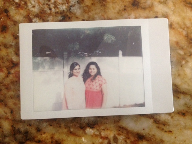 My wife and Smita in our backyard , taken from instax polaroid
